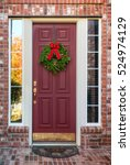 christmas wreath hanging on a... | Shutterstock . vector #524974129