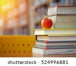 book stack on wood desk in the...   Shutterstock . vector #524996881