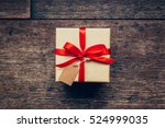 above brown gift box and red... | Shutterstock . vector #524999035