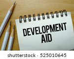 development aid text written on ... | Shutterstock . vector #525010645