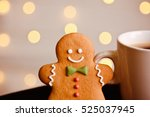 gingerbread man standing at cup ... | Shutterstock . vector #525037945