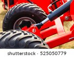 Small photo of Agriculture equipment concept. Detailed closeup agricultural machinery, big wheels with tires. Outdoor shot