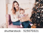 laughing mother open christmas... | Shutterstock . vector #525070321