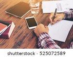 businessman working on a desk.... | Shutterstock . vector #525072589