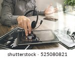 businessman hand using voip... | Shutterstock . vector #525080821