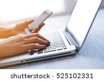 woman's hands using laptop and... | Shutterstock . vector #525102331