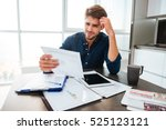 young confused man analyzing... | Shutterstock . vector #525123121