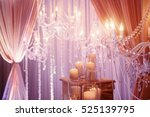 high white candles stand on the ... | Shutterstock . vector #525139795