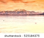 lake chiemsee with mountains in ... | Shutterstock . vector #525184375