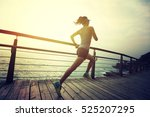 Stock photo young fitness sports woman trail runner running on seaside 525207295