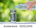 man's hand holding drinking... | Shutterstock . vector #525211945