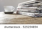 newspaper on wooden table | Shutterstock . vector #525254854