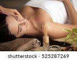 woman having a massage in a spa | Shutterstock . vector #525287269
