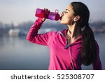 fitness woman drinking water  | Shutterstock . vector #525308707