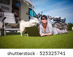 woman on the grass with a dog... | Shutterstock . vector #525325741