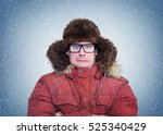 frozen man in winter clothes... | Shutterstock . vector #525340429