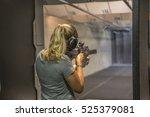 woman shooting at firing range.  | Shutterstock . vector #525379081