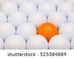 white and orange golf balls in... | Shutterstock . vector #525384889