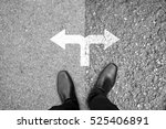 Small photo of Businessman in black shoes standing at the crossroad making decision which way to go - easy or hard