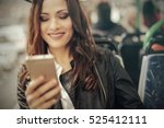 girl on her phone while... | Shutterstock . vector #525412111