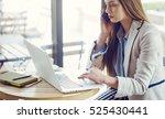 beautiful young woman working... | Shutterstock . vector #525430441