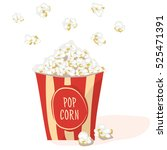 pop corn in a red stripped pack.... | Shutterstock .eps vector #525471391