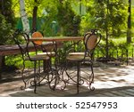 The cafe table with four old fashioned chairs from Kiev, Ukraine - stock photo