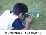 a boy use mobile very... | Shutterstock . vector #525502549