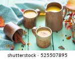 cups of golden milk | Shutterstock . vector #525507895