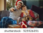 young couple at home with their ... | Shutterstock . vector #525526351