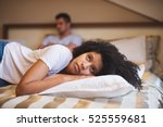 sad woman lying on bed after an ... | Shutterstock . vector #525559681