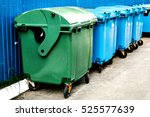 trash cans standing in a row | Shutterstock . vector #525577639