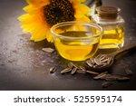 sunflower oil in bottle glass... | Shutterstock . vector #525595174
