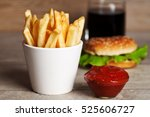 french fries on wooden table | Shutterstock . vector #525606727