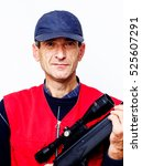 Small photo of Man with air rifle