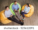three people sitting on beanbag ... | Shutterstock . vector #525612091
