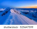 the moldoveanu peak in winter.... | Shutterstock . vector #525647599