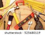 assorted work tools on wood | Shutterstock . vector #525680119