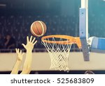 ball in hoop at basketball game | Shutterstock . vector #525683809