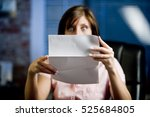 a woman looking at her mail ... | Shutterstock . vector #525684805