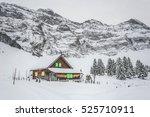 wodden cabin covered in snow in ...   Shutterstock . vector #525710911