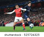 Small photo of LONDON, UK - NOVEMBER 23, 2016: Alexis Sanchez of Arsenal and Maxwell of PSG pictured during the UEFA Champions League Group A game between Arsenal FC and Paris Saint Germain on Emirates Stadium.