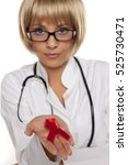 Small photo of attractive young doctor with blond short hair holding AIDS ribbon