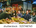 BARCELONA, SPAIN - DECEMBER 24, 2015: Food market befor Christmas. The Mercat de la Boqueria (Mercat de Sant Josep) is a typical Spanish market, located directly on the Rambla - stock photo