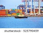 tugboat and crane in harbor... | Shutterstock . vector #525790459