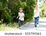 Two Young Thai Boy Run Togethe...