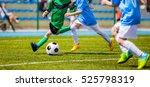 running soccer football players.... | Shutterstock . vector #525798319