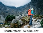 hiker woman with backpack... | Shutterstock . vector #525808429