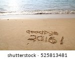 goodbye 2016 written on beach... | Shutterstock . vector #525813481
