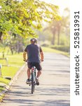 asian man cycling road in park... | Shutterstock . vector #525813931